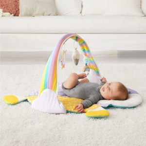 Baby playing with unicorn baby gym toys