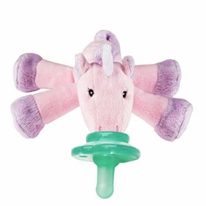 Pink and purple unicorn rattle with billy in mouth of the unicorn